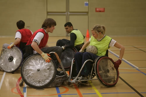 Playing basketball, using wheelchairs